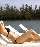 Sunny Leone, brunette, strip, bikini, piercing, outdoors, lake