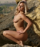 Laura, blonde, strip, thong, rocks, outdoors, flowers