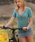 Molly Bennnett, blonde, strip, topless, bike, skirt