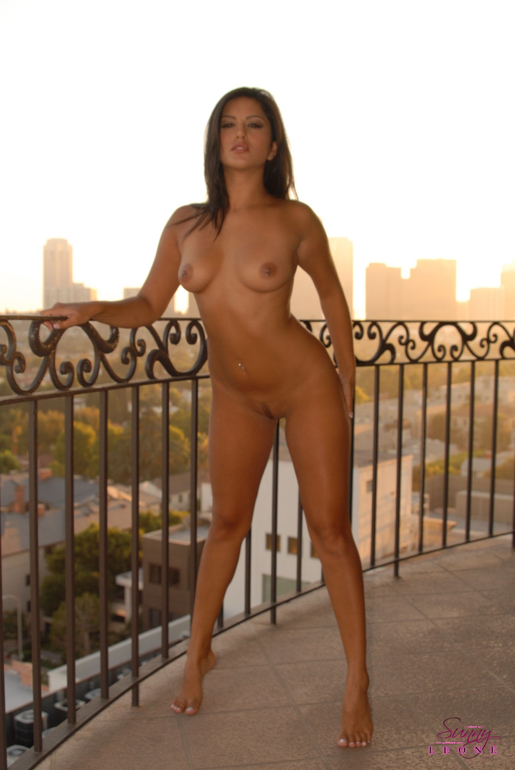 Sunny Leone, brunette, nude, outdoors, piercings